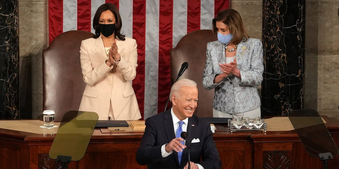U.S. President Joe Biden addresses a joint session of Congress as Vice President Kamala Harris (L) and Speaker of the House U.S. Rep. Nancy Pelosi (D-CA) (R) look on in the House chamber of the U.S. Capitol.