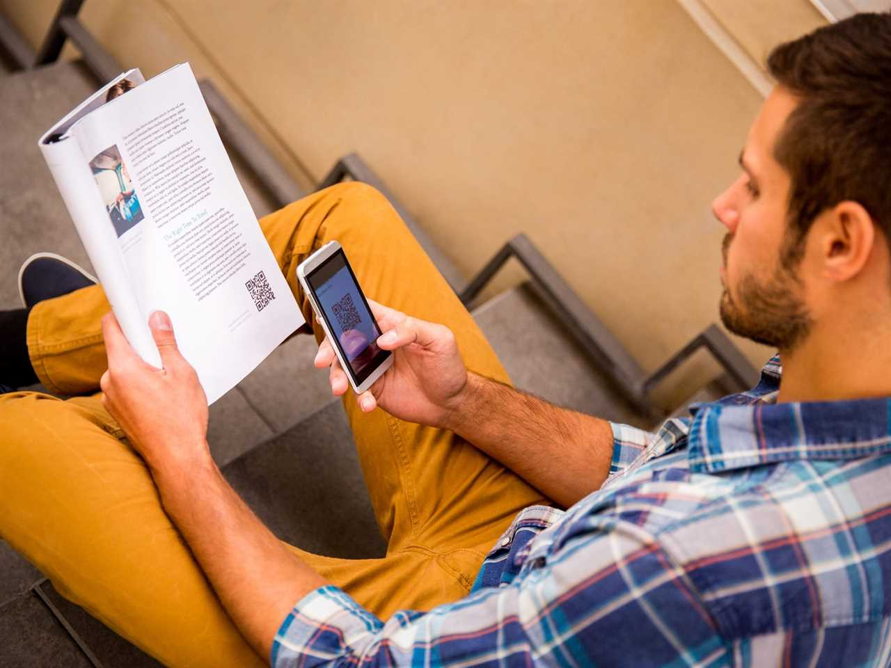 Man scanning QR Code in magazine