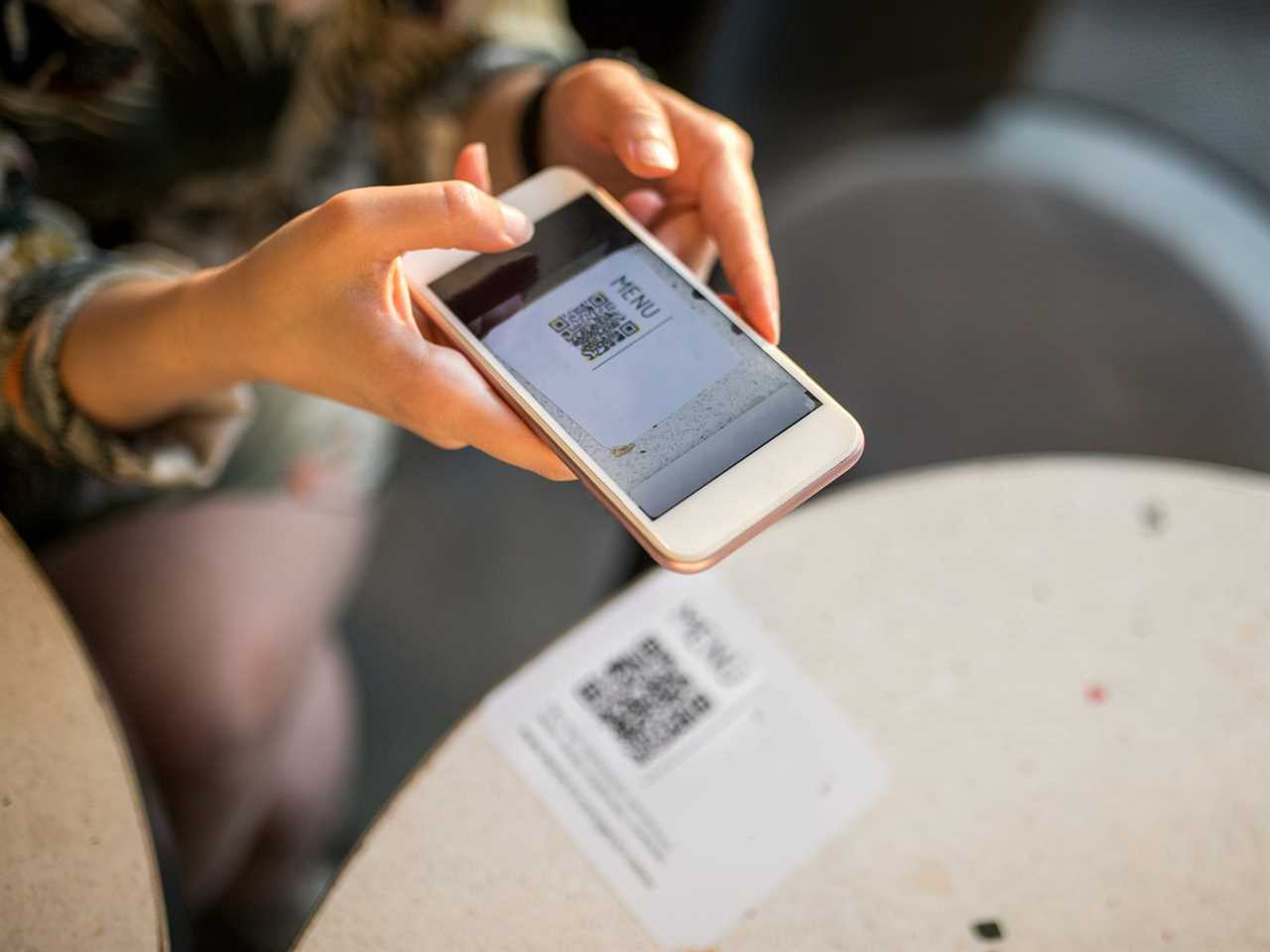 Scanning a QR Code at restaurant